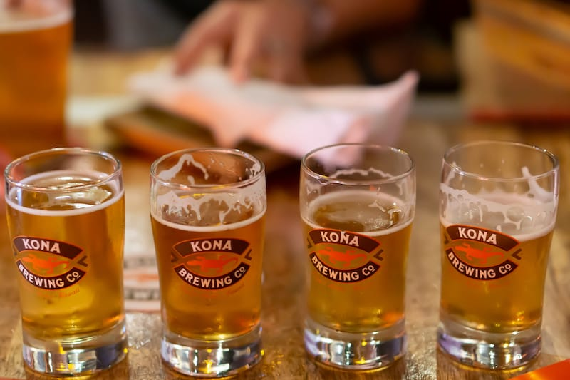 Kailua-Kona, Hawaii, October 2018. Flight of four beers sitting on a table at Kona Brewing Company.